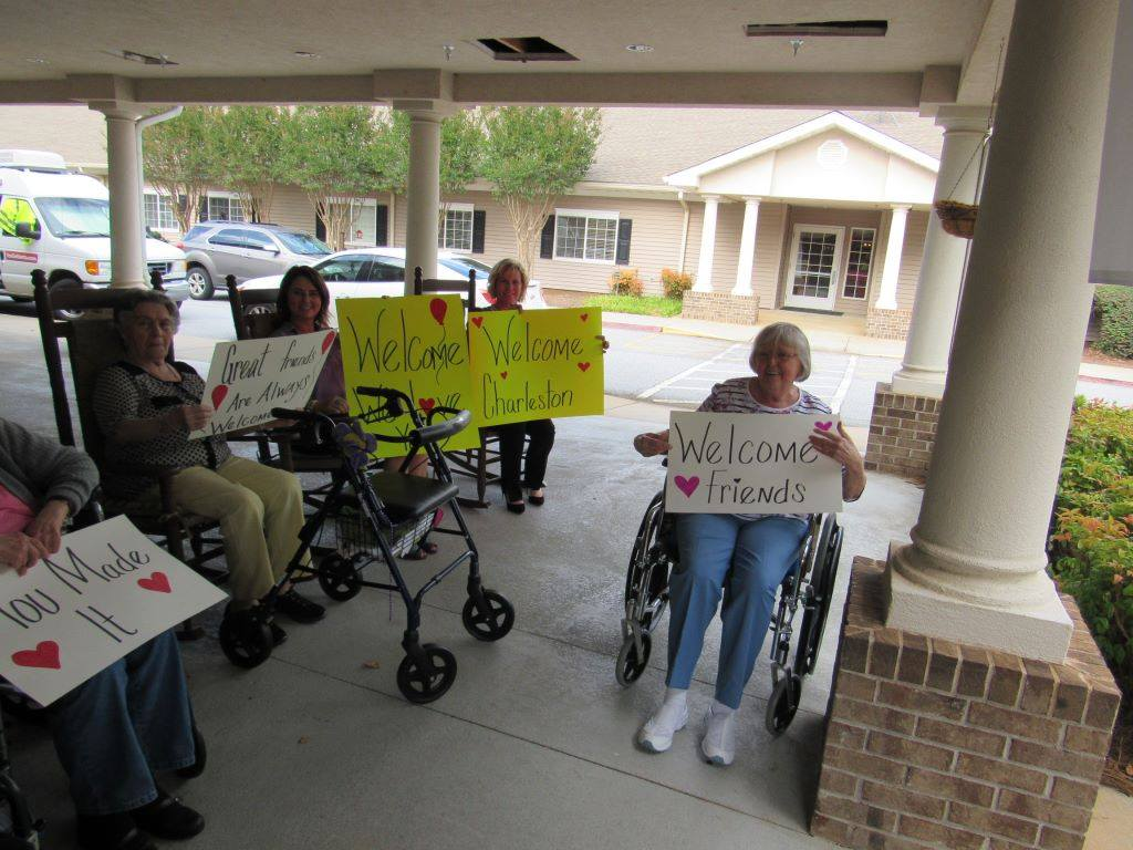 Residents with welcome sign