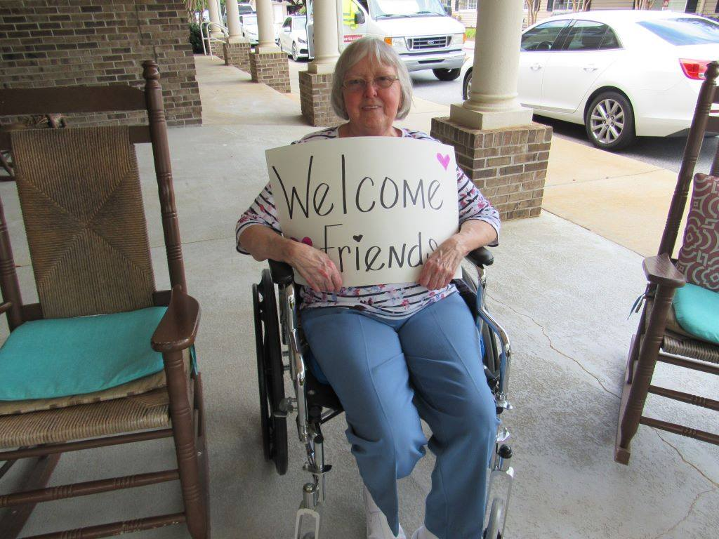 Resident with welcome sign