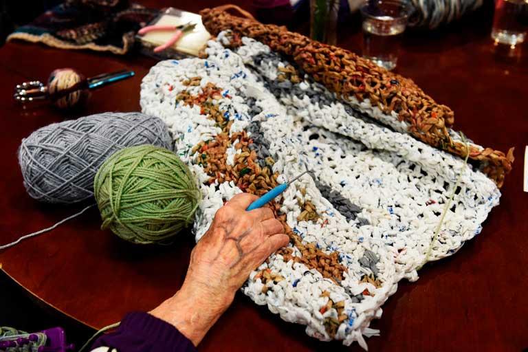 Senior knitting for needy