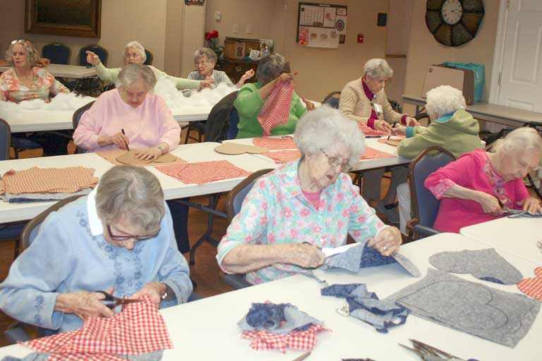Residents work to create pillows